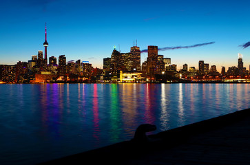 The Toronto, Canada skyline at night with reflections