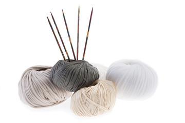 Pastel yarn hanks with set of wooden knitting needles