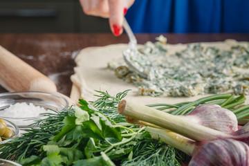 Making ciabatta bread with garlic, mediterranean olives