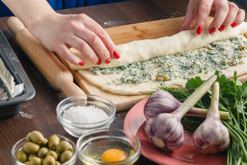 Making garlic bread with herbs