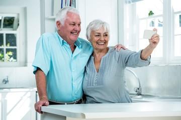 Confident retired couple taking selfie