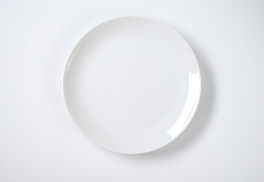 Coup shaped white plate