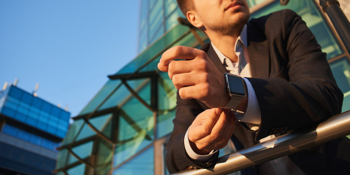 The guy in the suit shoots smart watch with hands