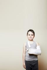 cute boy with broken arm