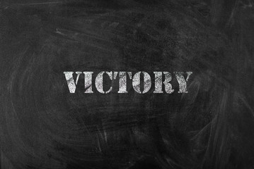 black chalk board with text victory