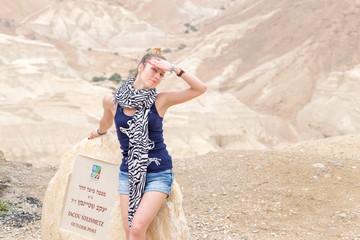 Beautiful young woman  model posing desert.