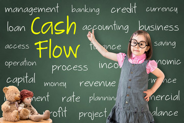 Cute little girl wearing business dress and showing cash flow concept on green chalk board.