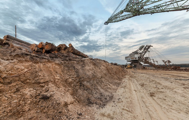 Many buckets of giant career excavator Equipment for the extraction of sand from the quarry. View from the semi-abandoned quarry