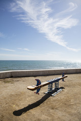 children's playground with seesaw with sea view in Sitges, Spain