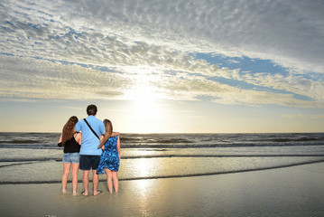 Father with his family enjoying time together, relaxing on vacation. Jacksonville, USA, Florida.
