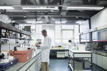 Male scientists working in a pharmacy laboratory, Freiburg im Breisgau, Baden-Württemberg, Germany