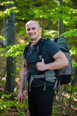 Happy hiker with backpack