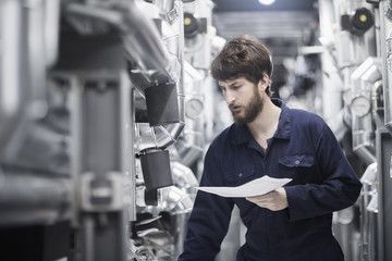 Young male engineer working in an industrial plant, Freiburg im Breisgau, Baden-Württemberg, Germany