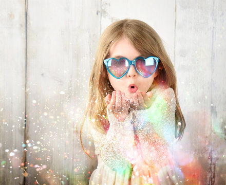 Child Blowing Colorful Party Sparkle Glitters