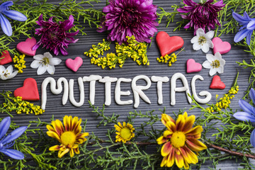 muttertag, written with plasticine surrounded by flowers