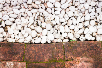 Pebble stones and bricks abstract background