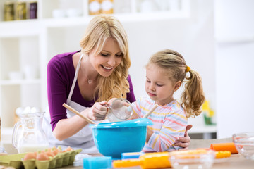 Woman and girl making homemade cookies
