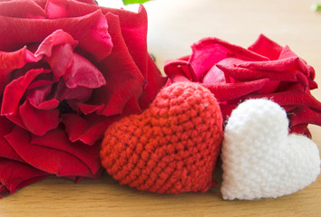 Heart with red roses on wood background