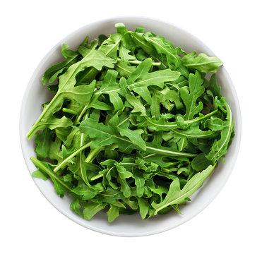 Bowl with fresh green salad arugula isolated on white background