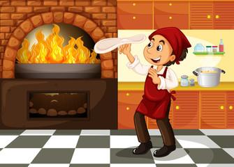 Chef making pizza at hot stove