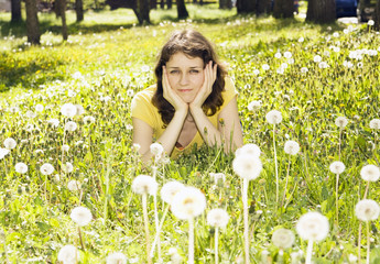 Young woman with white dandelions
