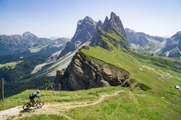 A man riding his mountain bike along trail, Dolomites, italy