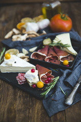 Slices of iberico ham and cheese tapas