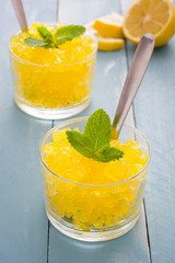 Lemon slushie on blue wood
