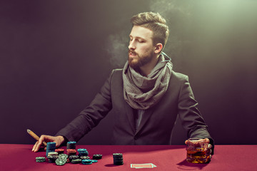 Bearded player at pocker table