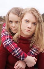 Two girls embracing