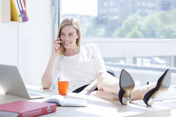 Beautiful young business woman in office