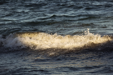 Beautiful light over small waves on ocean