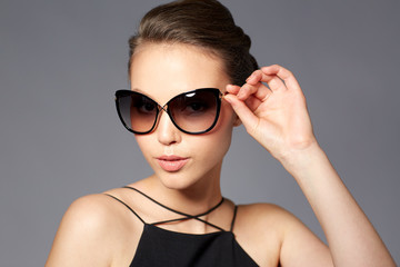 beautiful young woman in elegant black sunglasses