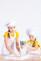 Children make the dough in the kitchen, roll a rolling pin
