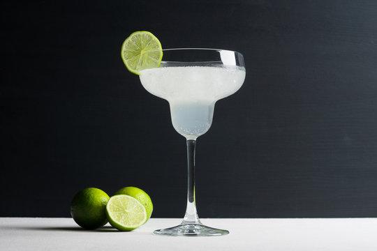 Cocktail margarita on the dark wooden background