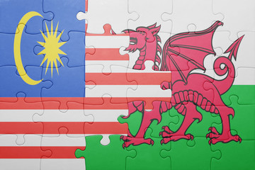 puzzle with the national flag of wales and  malaysia