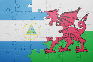 puzzle with the national flag of wales and  nicaragua