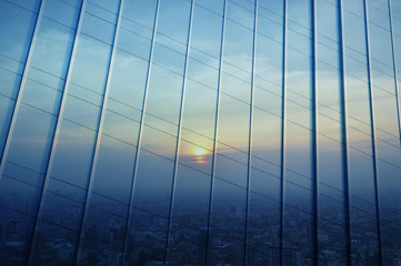 Fototapete - Reflect of aerial view of cityscape at sunset on metal wall, Ban