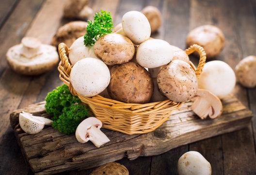 Champignon mushroom on the wooden table