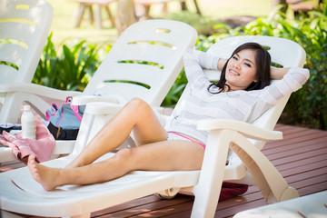 Asians  beautiful women lying poolside in a bikini