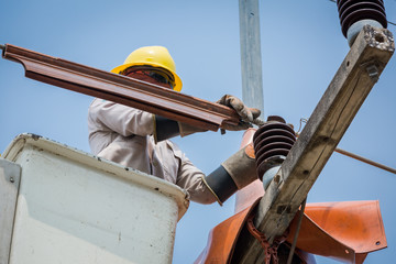 electricians repairing wire of the power line on electric power