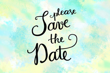 Please save the date hand lettering message on blue painted background