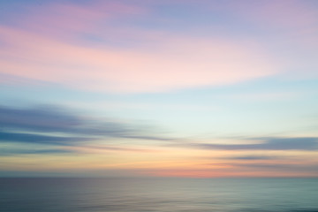 Poster Sea sunset Blurred defocused sunset sky and ocean nature background.