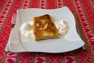 Strukle with cream - famous Croatian appetizer made with fresh c