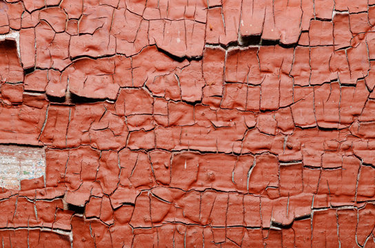 Red Painted old wall. Abstract cracked brown texture. Rustic background