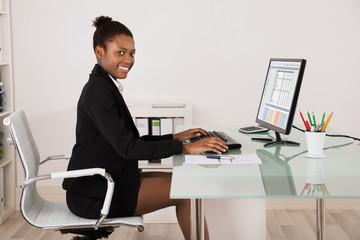 Happy Businesswoman Working In Office
