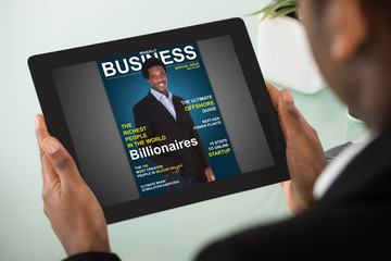 Businesswoman Reading Online Magazine