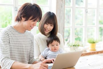 asian family using laptop