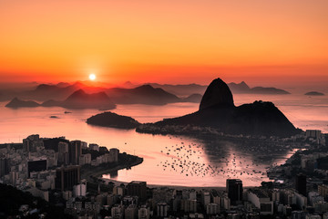 Golden Sunrise over Guanabara Bay in Rio de Janeiro with Sugarloaf Mountain in the Horizon