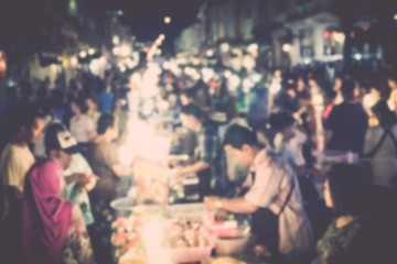 Blurred people are in walking street of old town